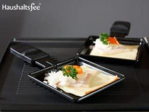 Käse auf Raclettegrill Pfännchen